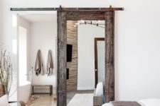 24 a sliding barn door with a mirror is a chic idea, a combo of modern and rustic things for a modern farmhouse