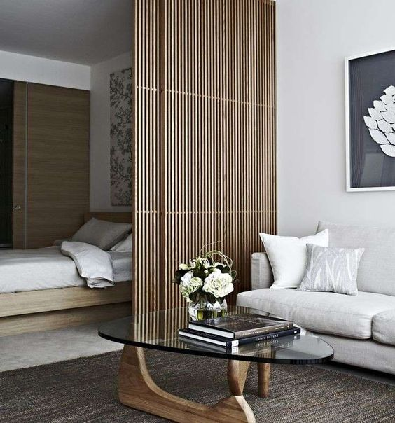 a very sleek bamboo screen is in absolute harmony with the minimalist aesthetics of this space