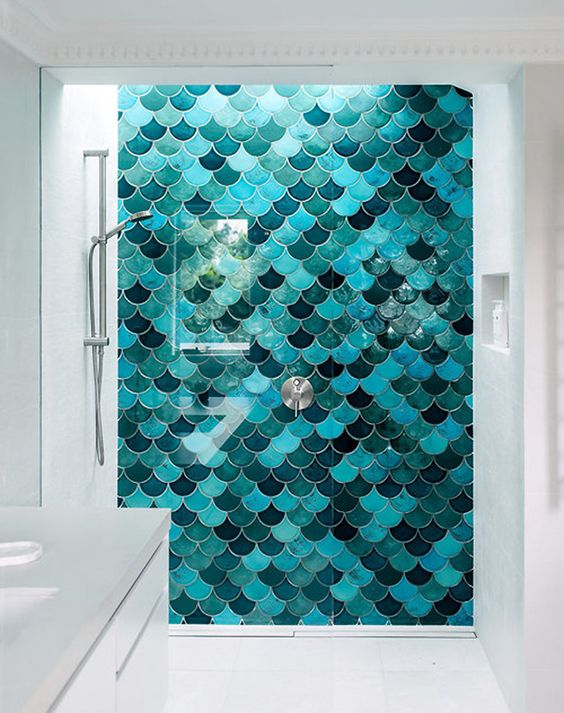 a super bold shower wall with fish scale tiles is a gorgeous way to add color to the bathroom