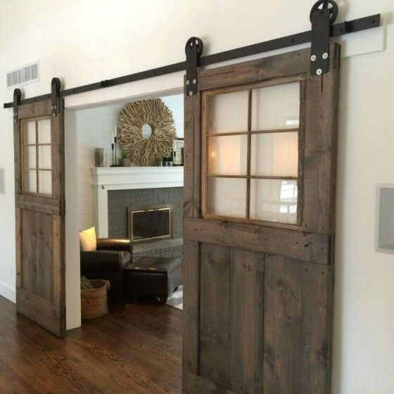 sliding barn doors with clear glass inserts make the look not too bulky and let the light in