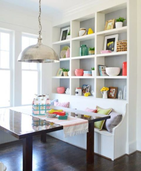 use a blank wall for a large storage unit with a built-in bench, it's a great solution