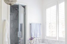25 white and grey marble was used to clad the backsplash and the bathtub to add a refined feel