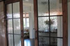 26 sliding barn doors with rainy glass inserts to make the doors look more subtle and let the light inside