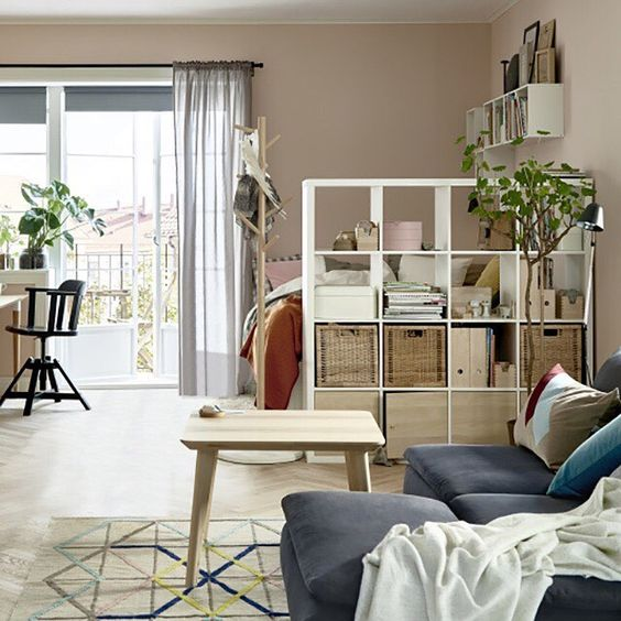 use IKEA Kallax unit to make your sleeping space in a studio more private and comfortable