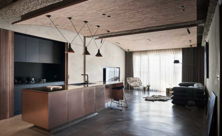 This amazing industrial home features much texture and a lot of natural materials used to create a chic combo