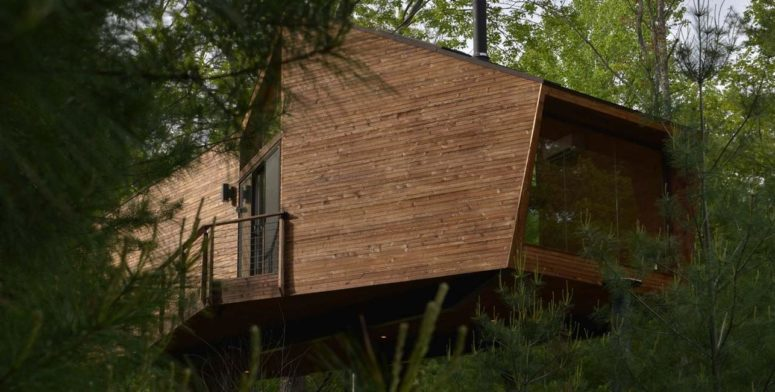 This gorgeous contemporary house is inspired by treehouses, of which many kids dream and here's the dream come true