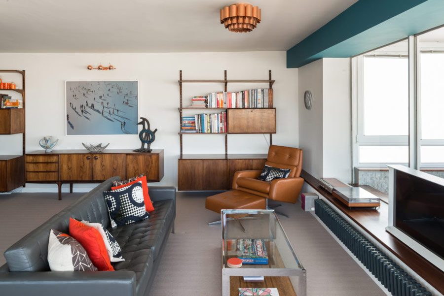 This gorgeous mid century modern apartment features ocean views and effective color blocking