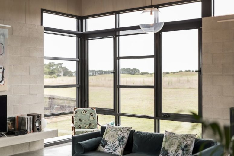 Inside the house, large windows give the living room views towards the sand dunes