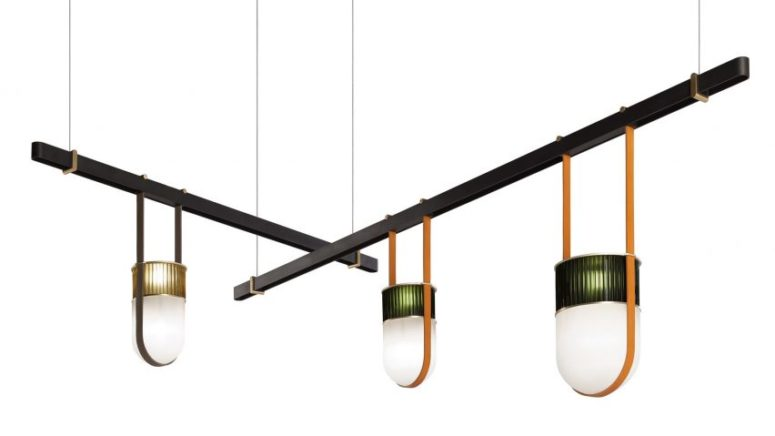 Pendant lamps hang from the beams on stripes of saddle leather, which is a support