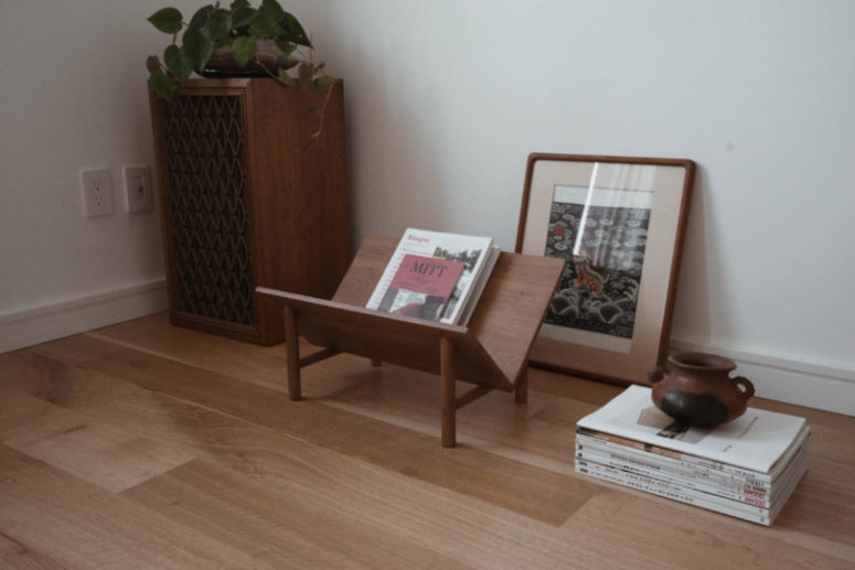 The furniture is made of wood and leather and features mid-century modern aesthetics