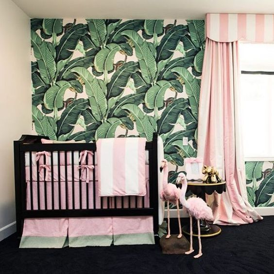 a glam tropical nursery for a girl, a tropical leaf wall, pink striped textiles, flamingos and gilded touches