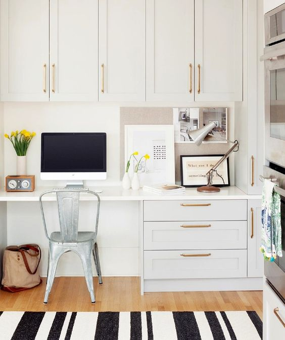 A White Glam Kitchen With Gilded Touches And A Built In Desk