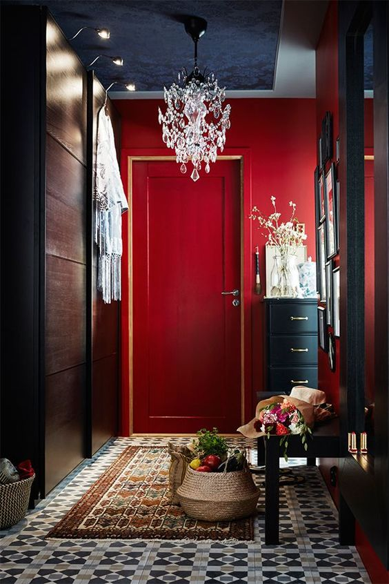 red as the main color for an entryway is great as it leaves a long impression