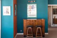 03 Teal and orange walls are used for color blocking and they remind of the ocean spaces around