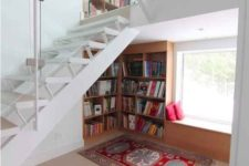 03 a comfy reading nook with a built-in bookcase and a window seat for reading