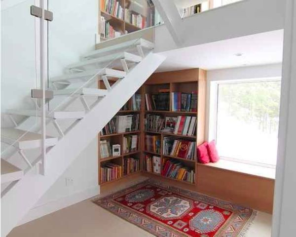 a comfy reading nook with a built-in bookcase and a window seat for reading