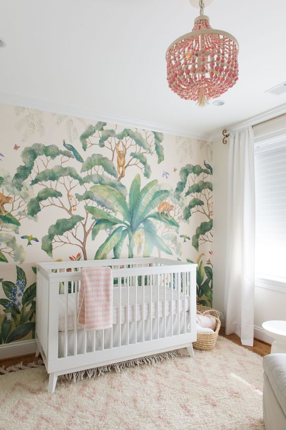 a peaceful tropical space with an eye-catchy wallpaper wall, a pink chandelier, a faux fur rug
