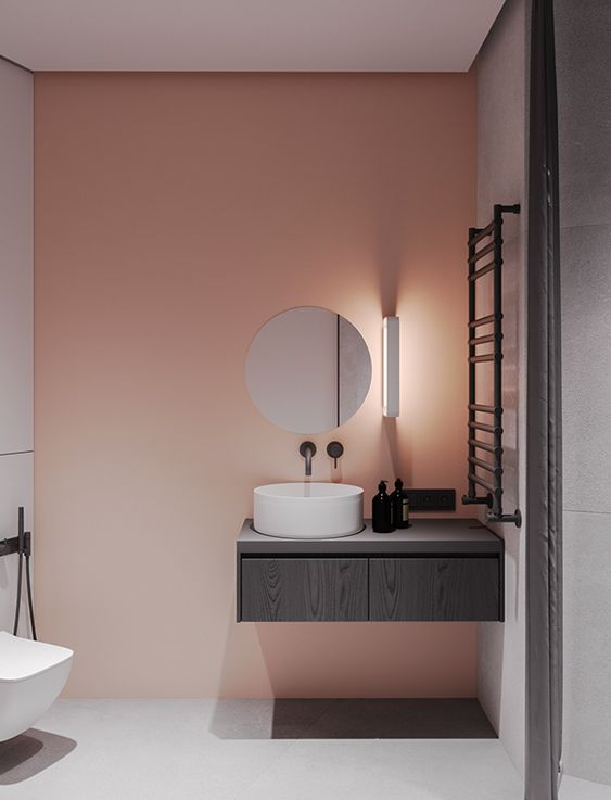 a pink painted statement wall to add a splash of color to a minimalist bathroom
