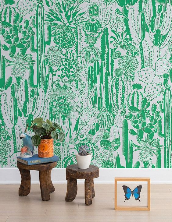 a super bold statement wall done with green and white cactus wallpaper