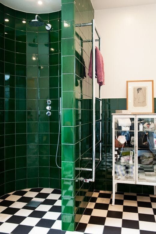 glossy emerald tiles to highlight the shower zone add a colorful touch and make the look bolder