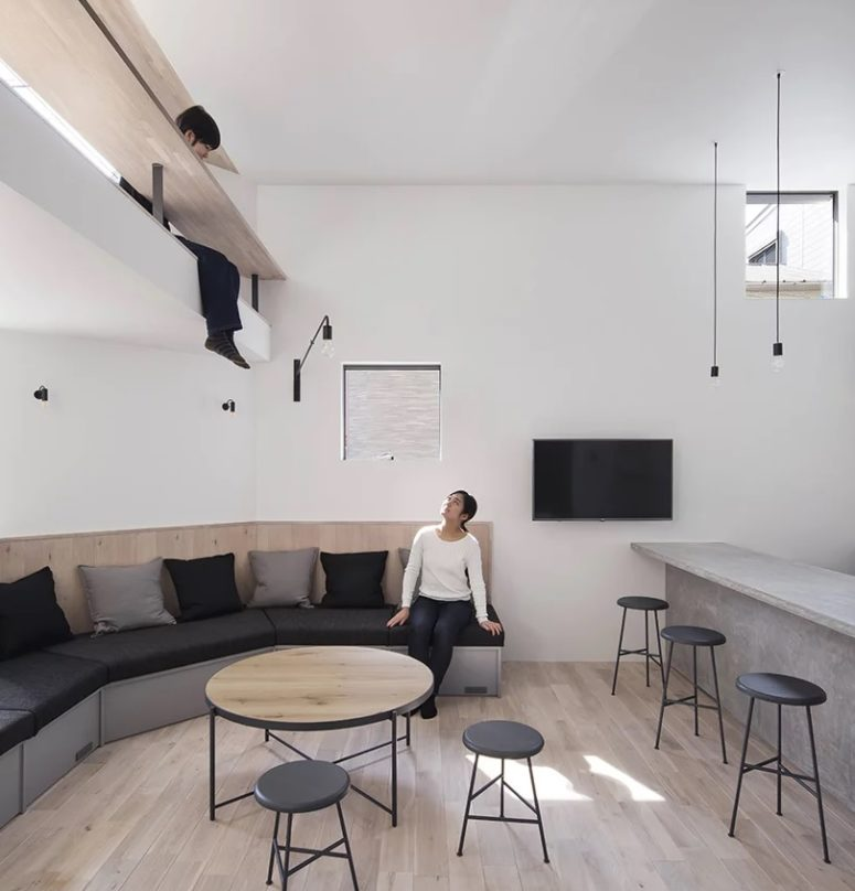 The ceiling of the open space becomes the floor and even a study or working space in the next zone