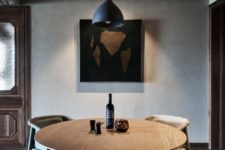 04 The dining space features artworks and a creative table with rocks inside the ethereal base
