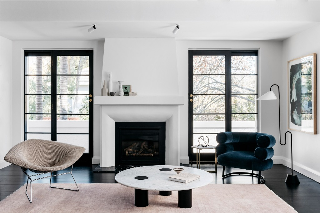 The impeccable taste, with which the furniture was chosen, just strikes, and look at that fireplace, that was newly built   isn't it perfect stylized