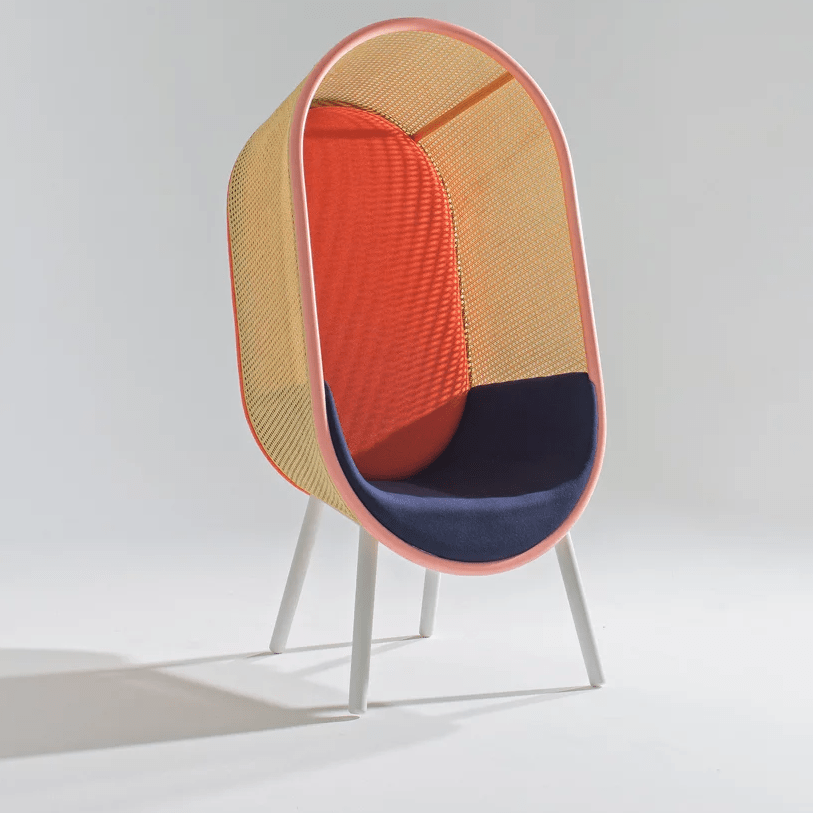 The red version features painted rattan and a navy seat and looks more mid century like