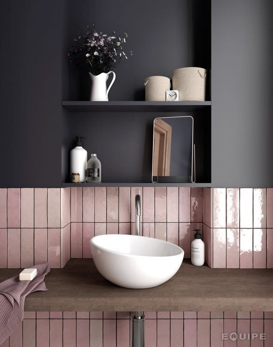 a combo of glossy pink long narrow tiles and a matte black cabinet over them for a chic modern look