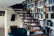 04 a cozy reading nook with built-in shelves into the wall and an upholstered beach for reading