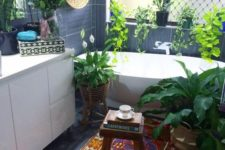 04 the bedroom is given a strong boho feel with potted greenery, a colorful rug and a wall basket