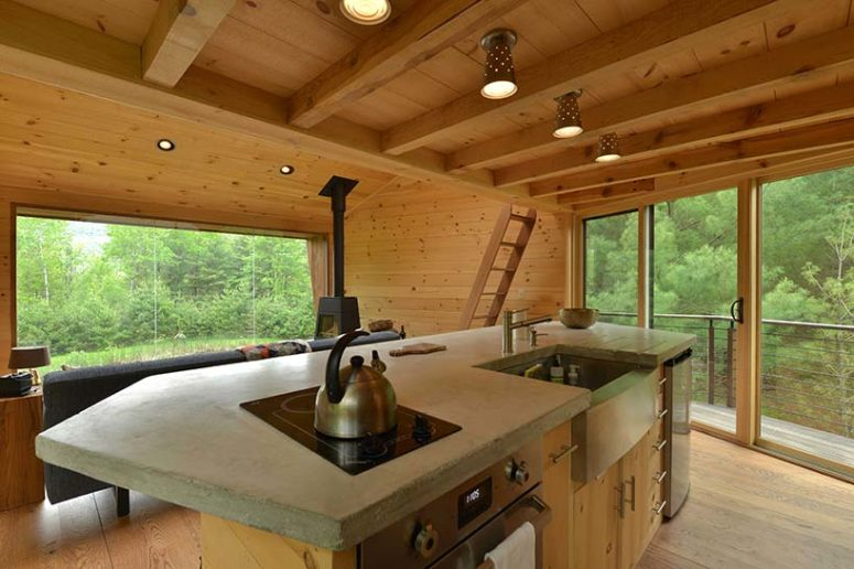 The kitchen island contains everything necessary for cooking, though not much storage space