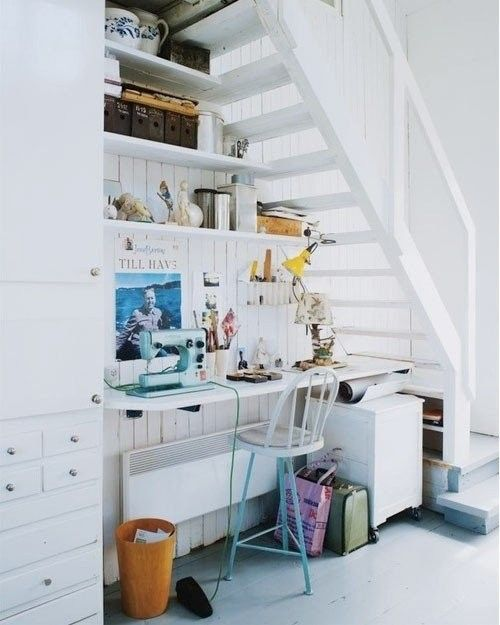 a home office gets much light thanks to the staircase with only steps and no risers