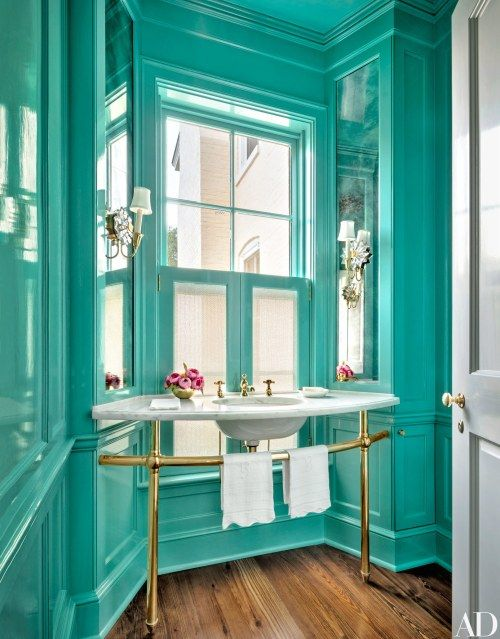 a bold turquoise powder room with brass fixtures and elegant touches is a unique idea to rock in your home