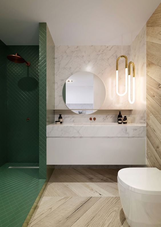 a luxurious look is achieved with the use of marble, wood and green tiles that clad the shower space