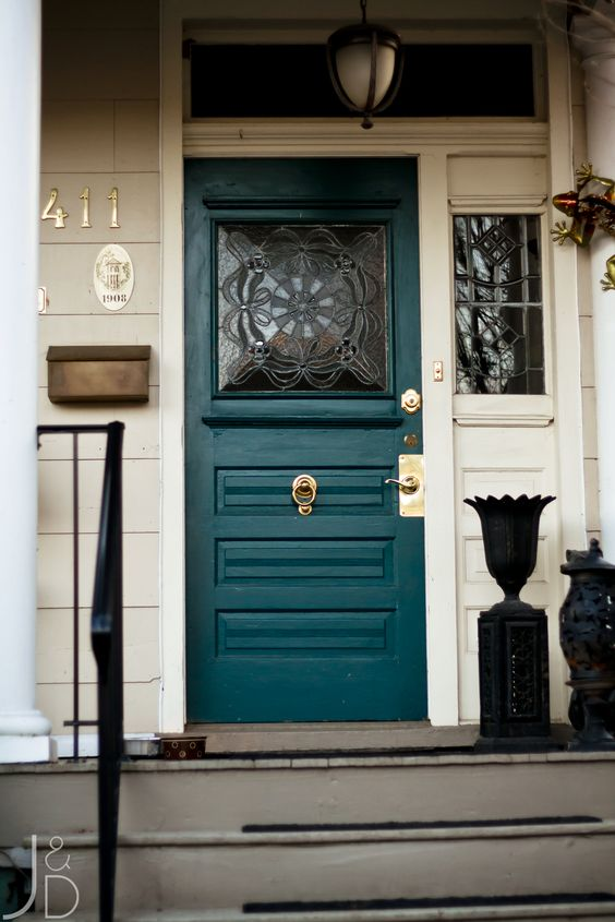 a stylish teal front door with a glass insert and gold detailing looks wow