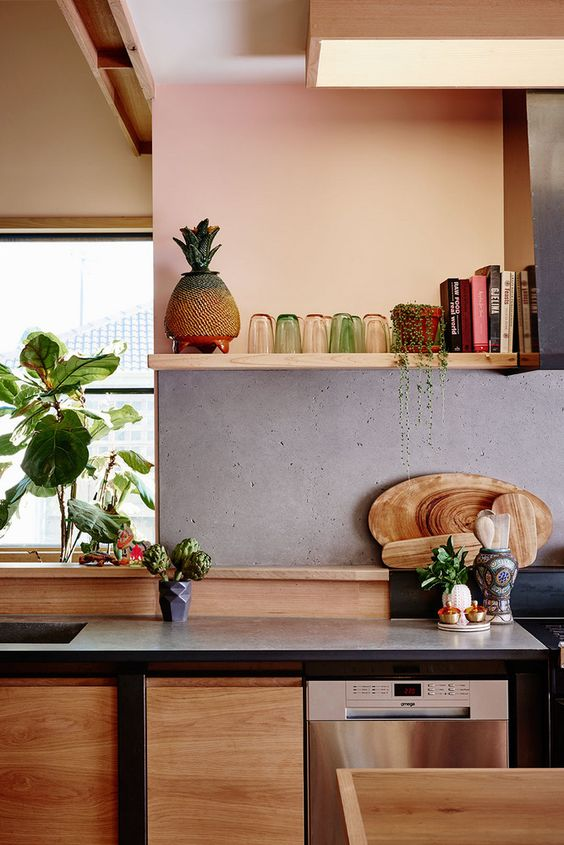 light colored wood contrasts the raw concrete backsplash, which makes the space cooler