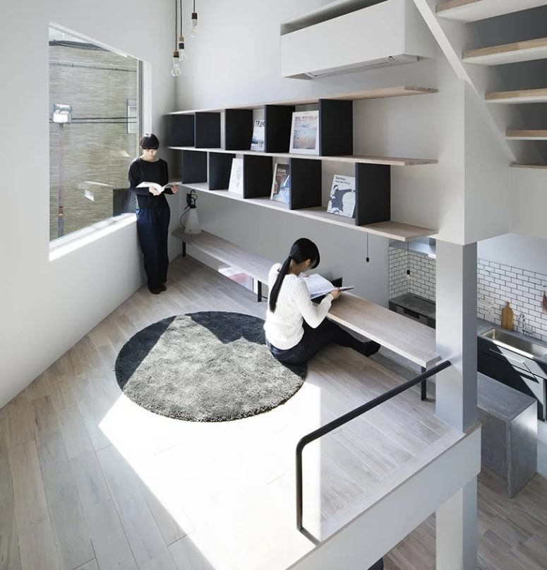 The sub level over the kitchen features a study or workspace with a creative desk built in above the floor