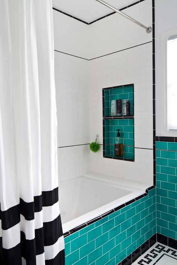 a black and white bathroom spruced up with turquoise tiles here and there to add a vibrant feel