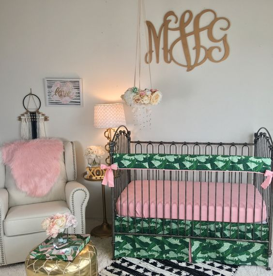a very colorful space with pink and palm leaf print textiles and all neutrals for a little girl
