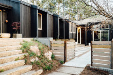 08 The exterior of the house is clad with black painted wood