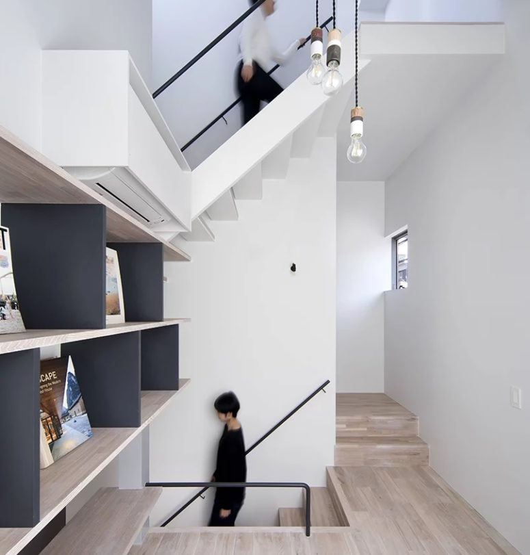There are several staircases to reach different rooms, the height of the ceiling is highlighted with pendant lamps