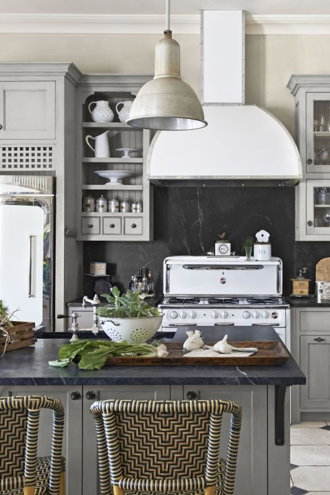 a modern farmhouse kitchen in greys with a chalkboard backsplash that adds a cool touch to the space