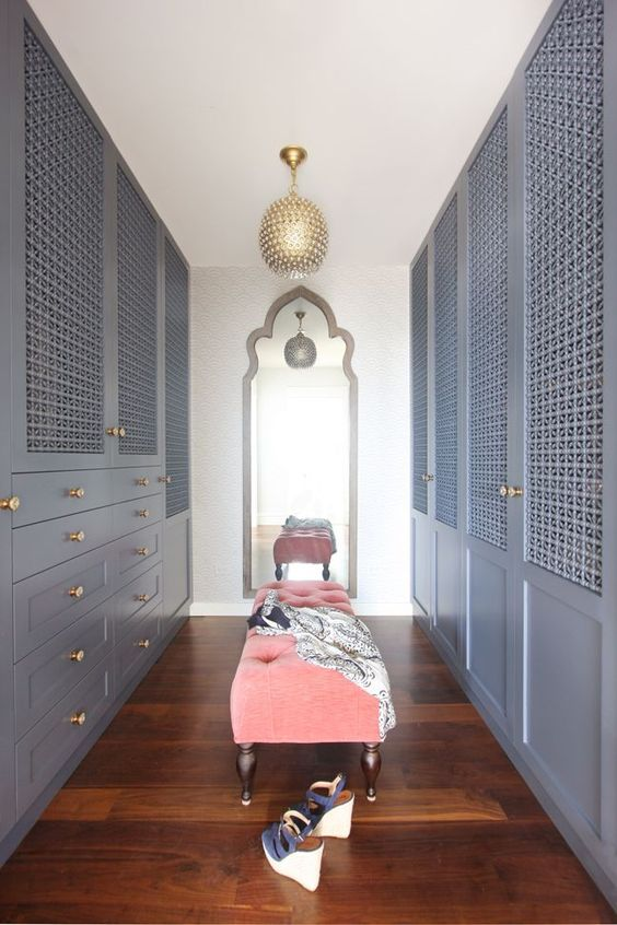a slate grey closet done with wood lattice doors looks very elegant with a vintage feel