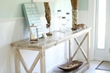08 a wooden rustic console, artworks, shells in a bowl, a sea horse of driftwood and lanterns