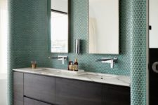 08 emerald penny tiles covering the sink zone highlight it and make a statement for a chic modern look
