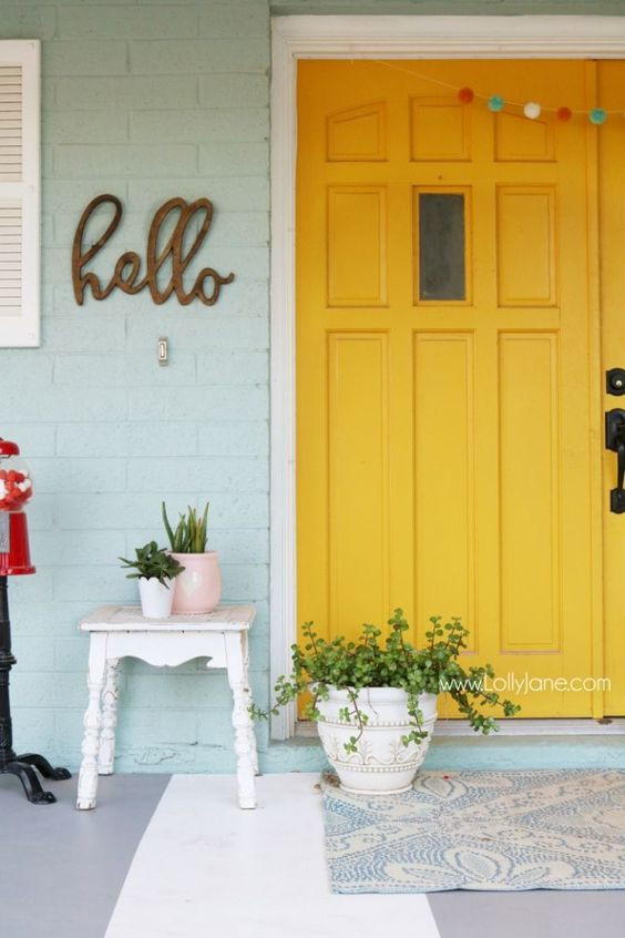 paint your front door bold yellow to add sunlight to the porch