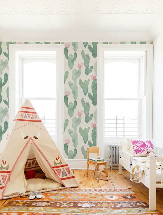watercolor is very trendy, and watercolor cactus print wallpaper is a dreamy option for a kid's room