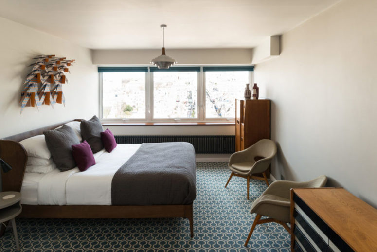 The second bedroom features more furniture for comfort, there are some colorful touches