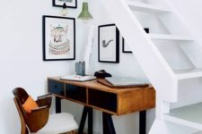 09 make your staircase as airy as you can to let some light inside and add hanging lamps over the working space